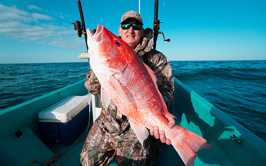 Man holding red snapper - Come and Take It Sport Fishing